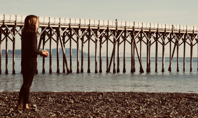 Child looking at pier