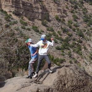 Grandkids balance on rock
